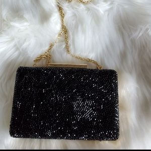 INC sequin and gold chain clutch